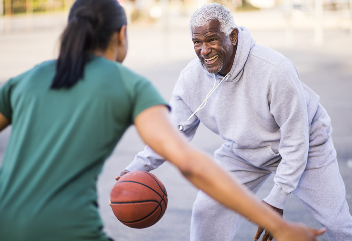 mature man playing basketball