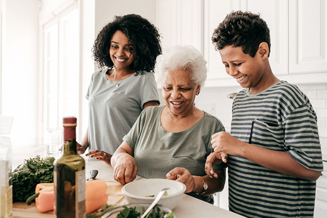 Grandmother, daughter and grandson cooking