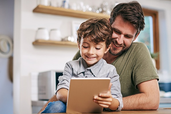 Father adding money online to his son's Foresters Plan
