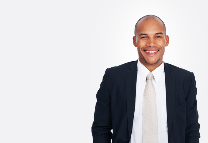 bald businessman smiling