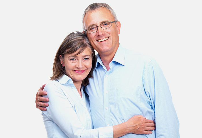 Happy man with arms around smiling woman