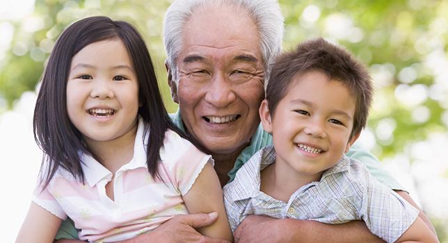 elderly man smiling with children